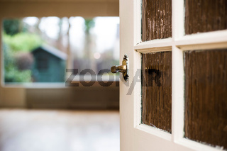 Door knob close-up to the livingroom, home concept