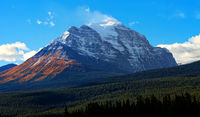 Mount Temple in fall with yellow larches in Banff National Park, Alberta