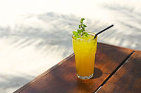 Cocktail Mai Tai with Light rum, dark rum, Orange Curacao, almond syrup, lime, ice cubes, pineapple and mint