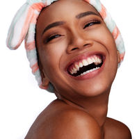 Portrait of a beautiful smiling woman with clean skin isolated on white background