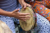 Woman's hands playing tambourine
