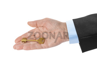 Hand with gold key