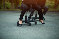 Businesspeople having racing on office chairs