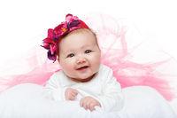 happy beautiful baby girl in tutu skirt and hat