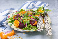 Salad of baked beetroot, arugula and pine nuts.