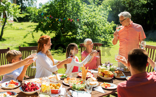 family gathering at summer garden and celebration