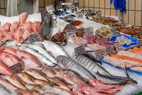 Market stall with fresh fish and seafood for sale seen in Brixton, London