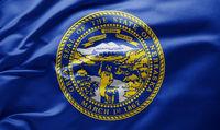 Waving state flag of Nebraska - United States of America
