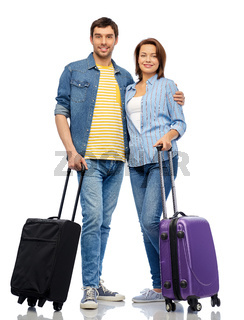 happy couple of tourists with travel bags