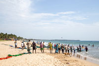 Fishermen at Uppuveli Beach in Trincomalee, Sri Lanka