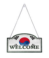 South Korea welcomes you! Old metal sign isolated