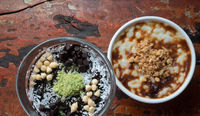 Turkish chocolate mousse pudding and rice pudding with walnut isolated on rustic wooden table