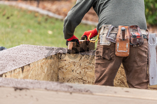 Construction Worker Leveling Wet Cement Into Wood Framing
