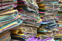 Files in different colors stacked up in office