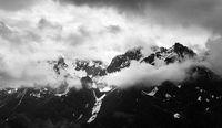 Cloudy Snowy Mountain Range Panorama in Monochrome