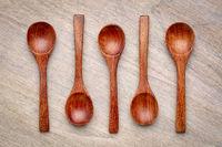 wooden teaspoons on grained wood