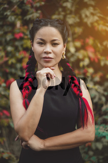 Charming Middle-Aged Asian is Posing for Camera Outdoor
