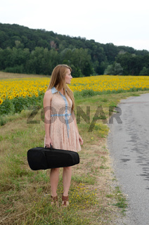Woman with vilolin by country road