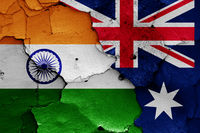 flags of India and Australia painted on cracked wall