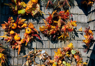 Autumn wreath decorations on wooden wall