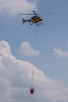 Helicopter with water tank for extinguishing fires, Beromünster, Lucerne, Switzerland, Europe