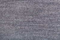 woven yarns in gray jersey knitted fabric close up