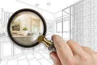 Hand Holding Magnifying Glass Revealing Custom Bathroom Design Drawing and Photo Combination