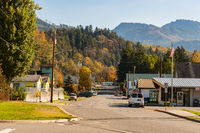 View of the main street of Concrete with the forest and mountains in the background, Washington, USA