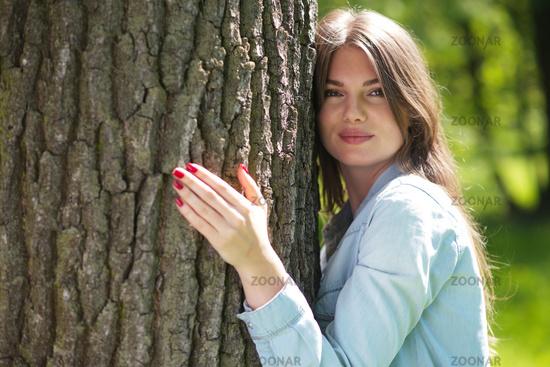 Woman hugging a big tree
