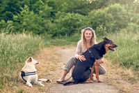 Happy blond woman with her two loyal dogs