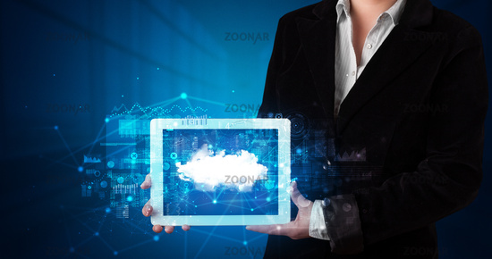 Hand holding tablet with cloud technology concept
