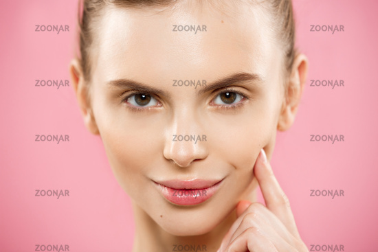 Beauty Concept - Close up Portrait of attractive caucasian girl with beauty natural skin isolated on pink background with copy space.