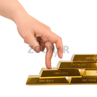 Hand and stairs made of gold bars