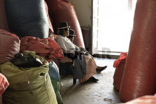 October 14, 2012 - Sud Yungas, Bolivia: Two Indigenous Women Surraunded With Large Sack Full Of Coca Leaves At The Coca Leaf Depot In Chulumani, Bolivia