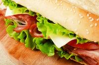 Large subway baguette sandwich cut in half filled