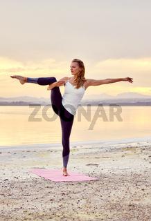 Yogi woman do balancing yoga pose outdoors