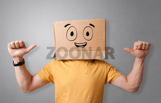 Man with smiling carton box head
