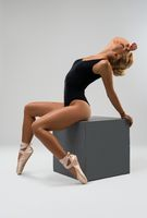 Young girl in pointe and lingerie on the cube