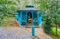 Lovely turquoise gazebo in garden