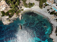 Cala en Cranc rocky seaside in the Palma de Mallorca directly from above drone point of view photo, picturesque nature stony beach turquoise Mediterranean waters from top image, Balearic Islands Spain