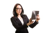 Portrait of business woman in eyeglasses holding tablet computer