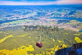 Mount Pilatus aerial cabelway above cliffs and Lake Lucerne landscape