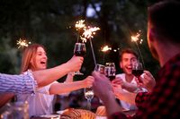 happy friends having french dinner party outdoor