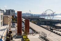 Chimney, highway and waterwheel next to Elliott Bay in Seattle, Washington, USA.