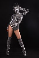 Woman in shine metal chain mail costume