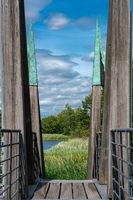 architectual striking wooden pedestrian bridge with wild nature