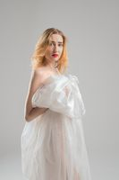 Slim blonde wrapped in white cloth view