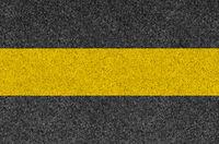 Black asphalt background texture with yellow line