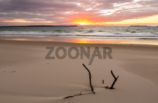 Sunrise over the ocean with beautiful unspoilt beach