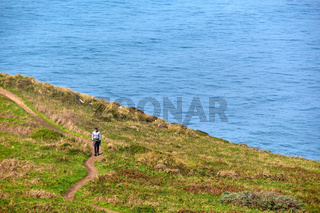Lone man walking at pacific coast